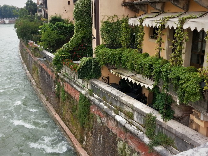Riverside mossy buildings Verona